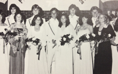 """After being crowned, the 1980s homecoming court takes a picture. """"I would rather go to homecoming in the 80s,"""" sophomore Griffin Sheridan said. """"The music was better."""" Most of the music played at this year's dance was club music."""