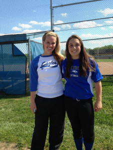 Claire Lovins stands next to her coach, Victoria Zelmanski, before a game.