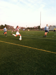 During the first half, senior outside defender Taylor Kastens crosses the ball into the 18 yard box.