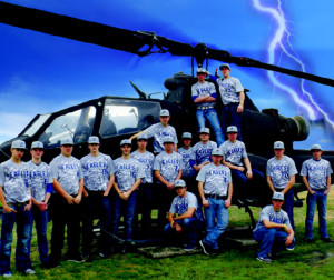 "The Men's Varsity Baseball team shows off their new camoflauge jerseys in front of a helicopter at Selfridge Air Base. ""We felt it was a nice keepsake for the boys, putting their names on the back and allowing them to keep them after graduation,"" Gendreau said."