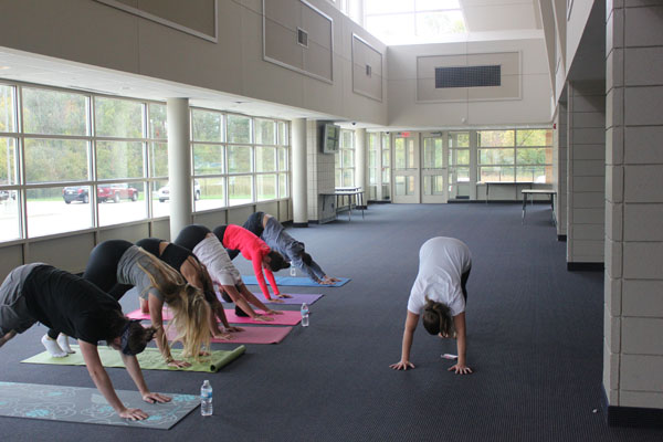 """The yoga club practiced many poses throughout the 15 weeks the club met. """"We had so much fun throughout the year, and we worked really hard,"""" junior Savanna Cooper said. The club has had its last yoga session and is done for the year."""