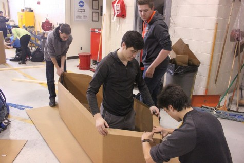 Seniors Cameron Nolff, Jacob Peck, Dominic Rende and Brandon VanOphem work on their boat