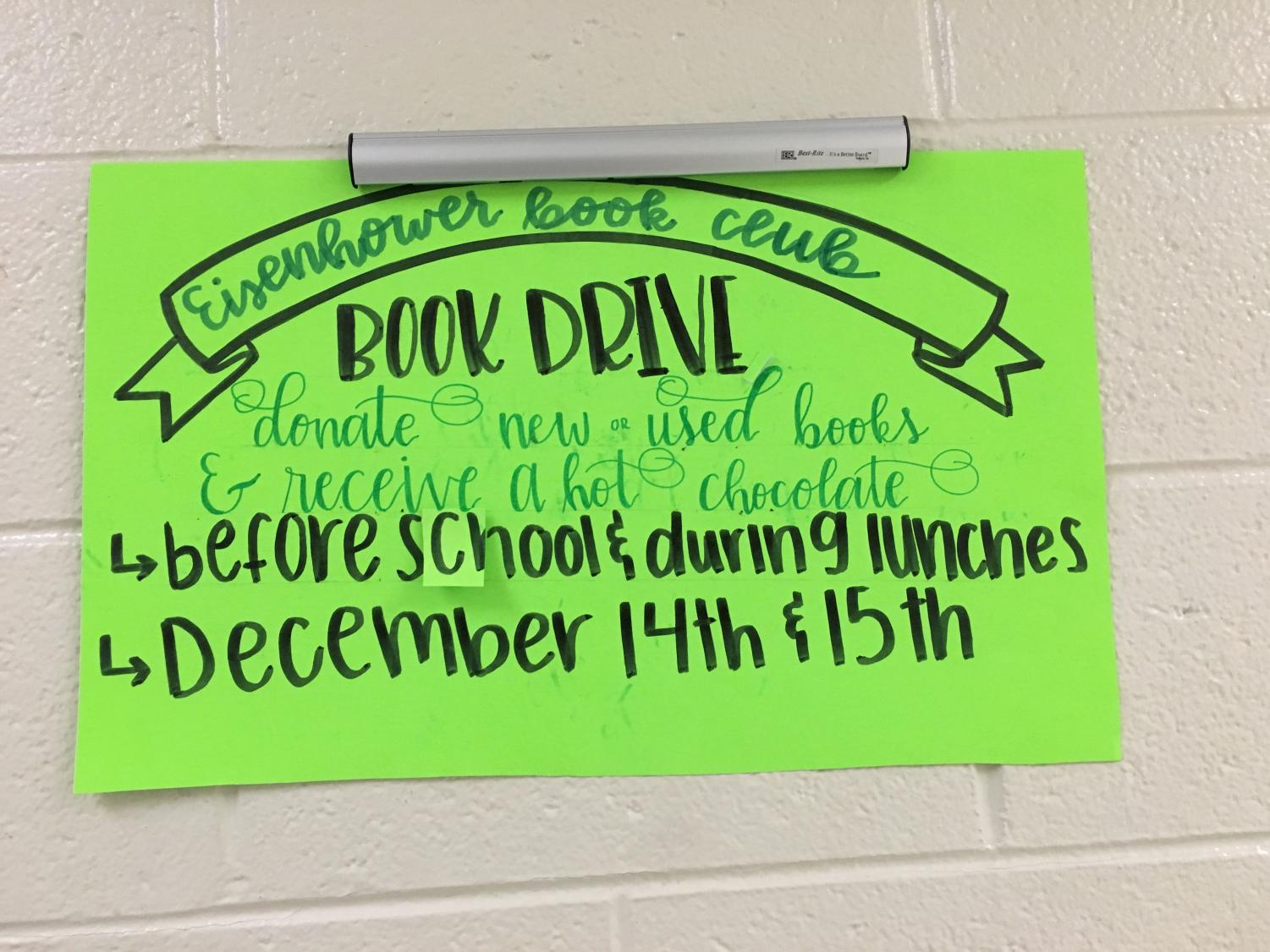 A poster is hung up in hallway to advertise the book donation.