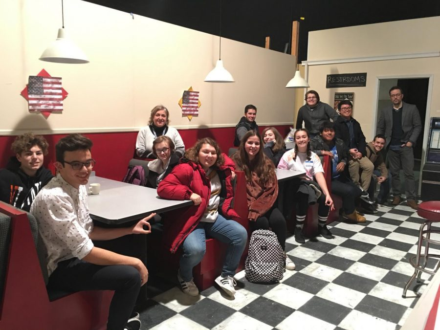 Film+teacher+Josephine+Braun+and+the+students+on+the+trip+sit+on+a+movie+set.