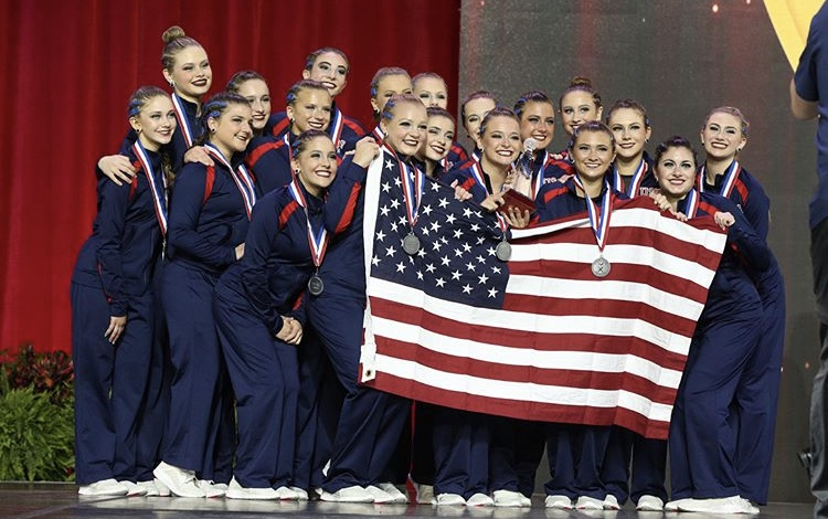 Representing the U.S. the varsity dance team display their silver medals for jazz. They are the first high school team in the history of America to compete at an international competition.