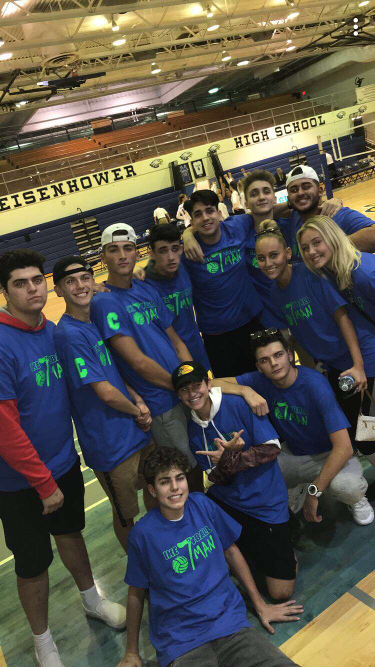 The God Squad wears their matching t-shirts to supporting the women's volleyball team at a home volleyball game.