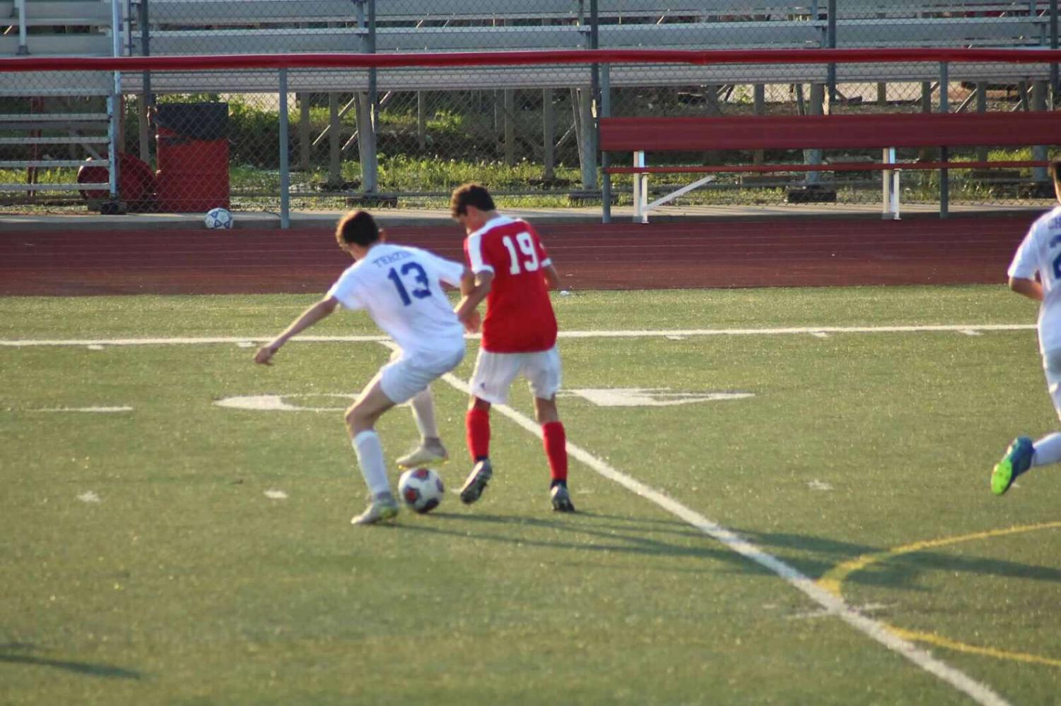 Sophomore Pietro Terzini steals the ball from opponent.