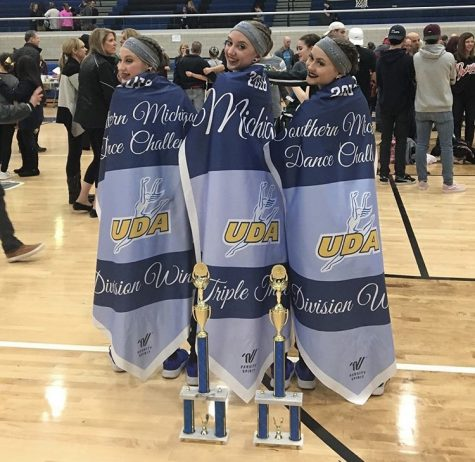 Kayleigh Messina, right, at the UDA Southern Michigan Regional competition alongside teammates Emma Leykauf, left, and Emma Seaglund, center.
