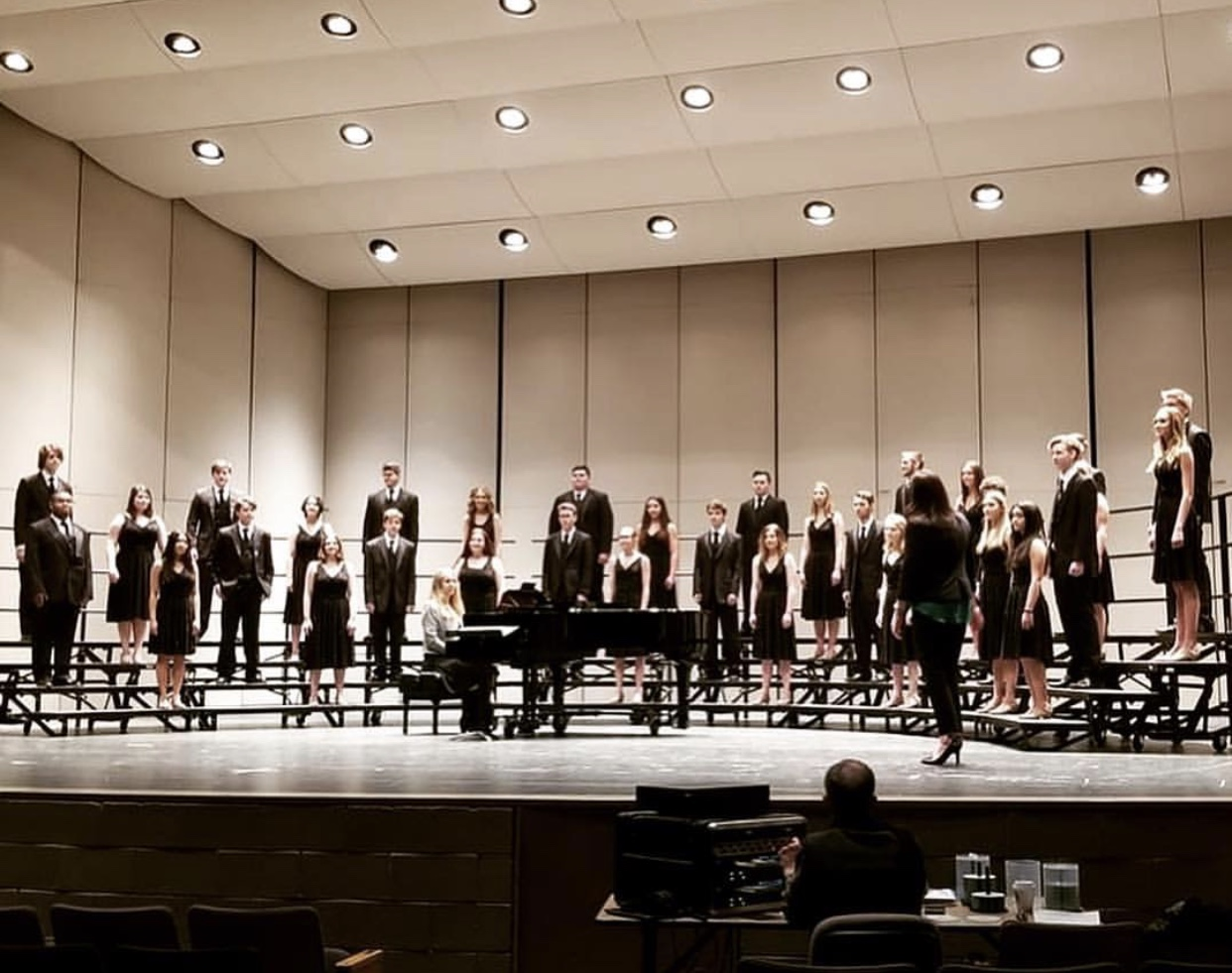 Show Choir on stage preforming at District Choral Festival.