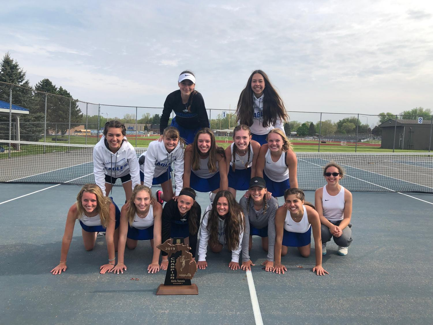 Womens varsity tennis team happy after winning their regional and advancing to States.