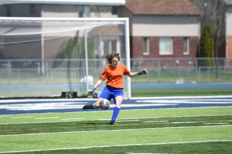 Junior Allison Auten playing soccer.