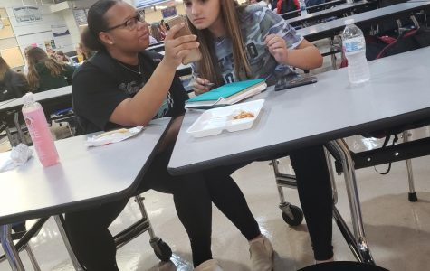 """While at lunch, sophomores Piper Rodriguez and Neveah Rowe shared memes on their instagram feed. """"I show her a lot of things because it annoys her,"""" Rowe said, although Rodriguez"""