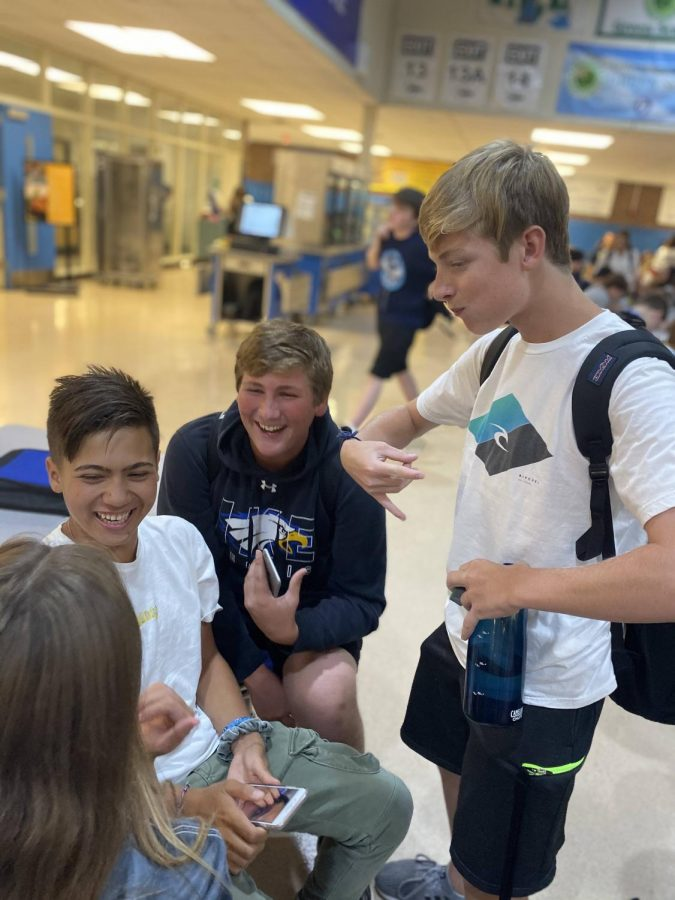 """Surrounded by friends at lunch and talking about jokes of the past, sophomore Anthony Franco laughs at the story being discussed. """"Kevin told us a story about how last year he actually got something messed up on his shirt at hoco,"""" Anthony said. """"We talked about tennis and how we're hoping to do it next year."""" The boys had a good laugh at lunch and enjoyed each other's company."""