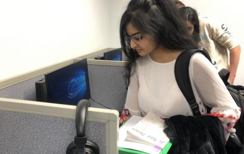 """Shifting from her French homework, Junior Muanqa Imtiaz is seen as she leaves the language lab. """"They're [assignments] too hard,"""" Imtiaz said. Her and her classmates returned to the class to read Le Petit Prince"""