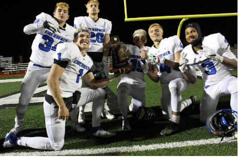"The team celebrates their District Championship win over Lake Orion on Friday, Nov. 8, 2019 sporting their traditional playoff bleached hair. ""It's something we do here every time we have playoffs and usually the whole team gets their hair bleached,"" senior quarterback Blake Rastigue said.The bleached hair dates back to 1999, according to head coach Chris Smith. Courtesy photo/ikefootball.net"