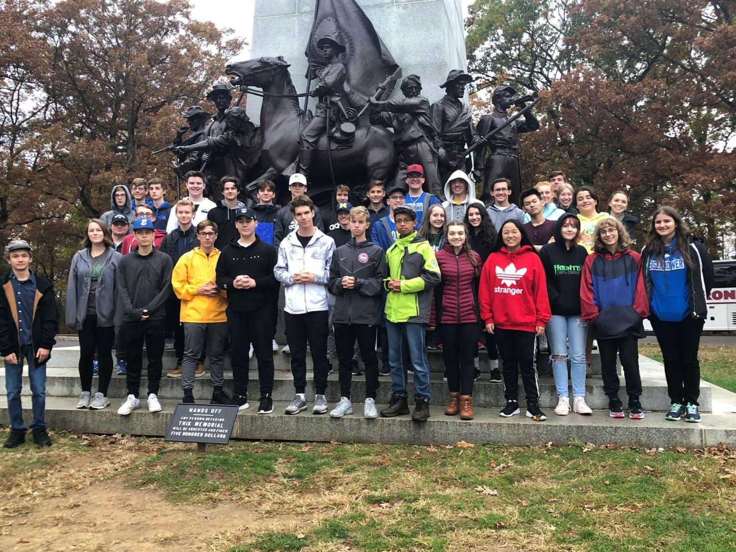 "The AP U.S. history students stand in front of the Robert E. Lee statue in the battlefield of Gettysburg. ""Gettysburg holds a lot of important information about our history and I think this statue is also an important part of our history,"" sophomore Ashton Tokarz said. They toured Gettysburg's battlefield throughout the day."