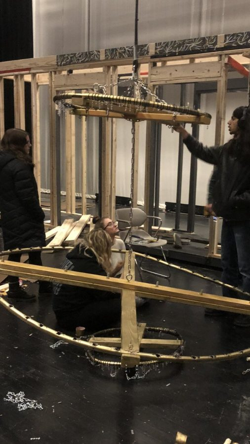 "Engulfed in their work, seniors Isabel Hafner, Satbir Mangat, Anna Schimdt and Samantha Ludwig create the chandelier for the show. ""I think that it is why I ended up getting into stagecraft and the theater aspect of the school in general. And I taught myself a bunch of other aspects I use to build."" Mangat said. They spent their time since September producing the stage for the show."