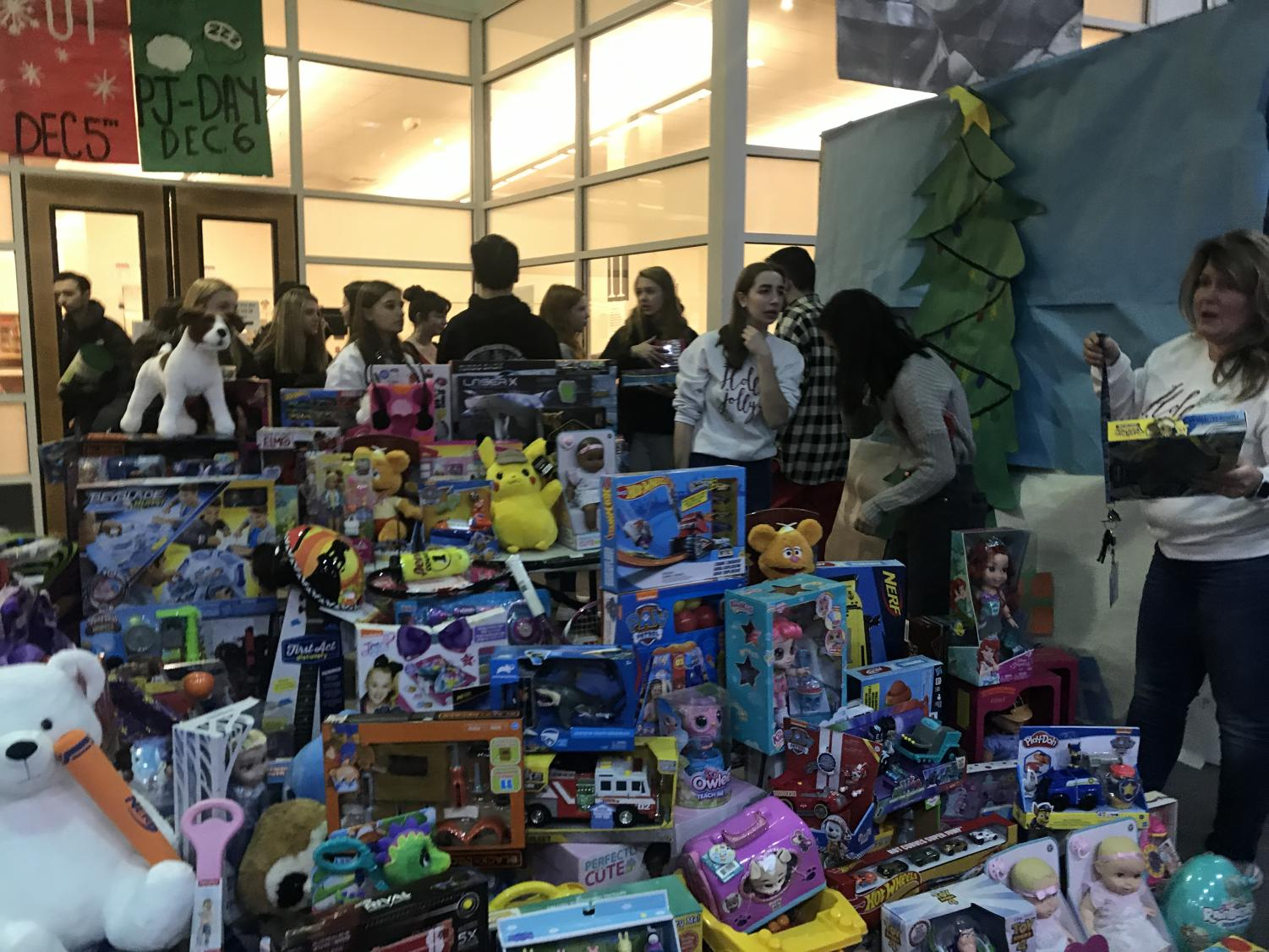 Student council members set up the toy results from the Toys for Tots drive for the Marines to pick up.