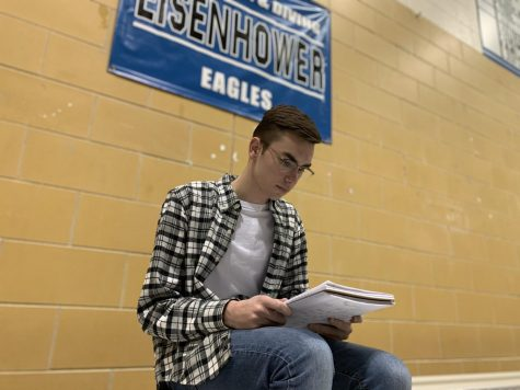 "While studying with free time before practice, senior swimmer Michael Hagen makes sure he knows the material for his Wednesday exam. Michael practiced dryland exercises after studying with the meets being the week of exams. ""I"