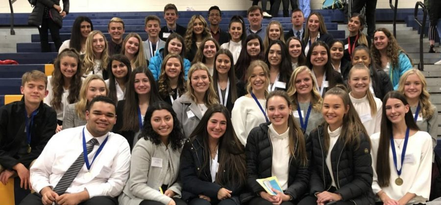 "With medals around their necks, Health Occupations Students of America (HOSA) members celebrate their regional competition success. ""I feel I performed very well. I just used my prior knowledge and just showed it off,"" junior Alessandra Gigliotti said. Giolitti placed third, which qualified her for States along with 25 other members."