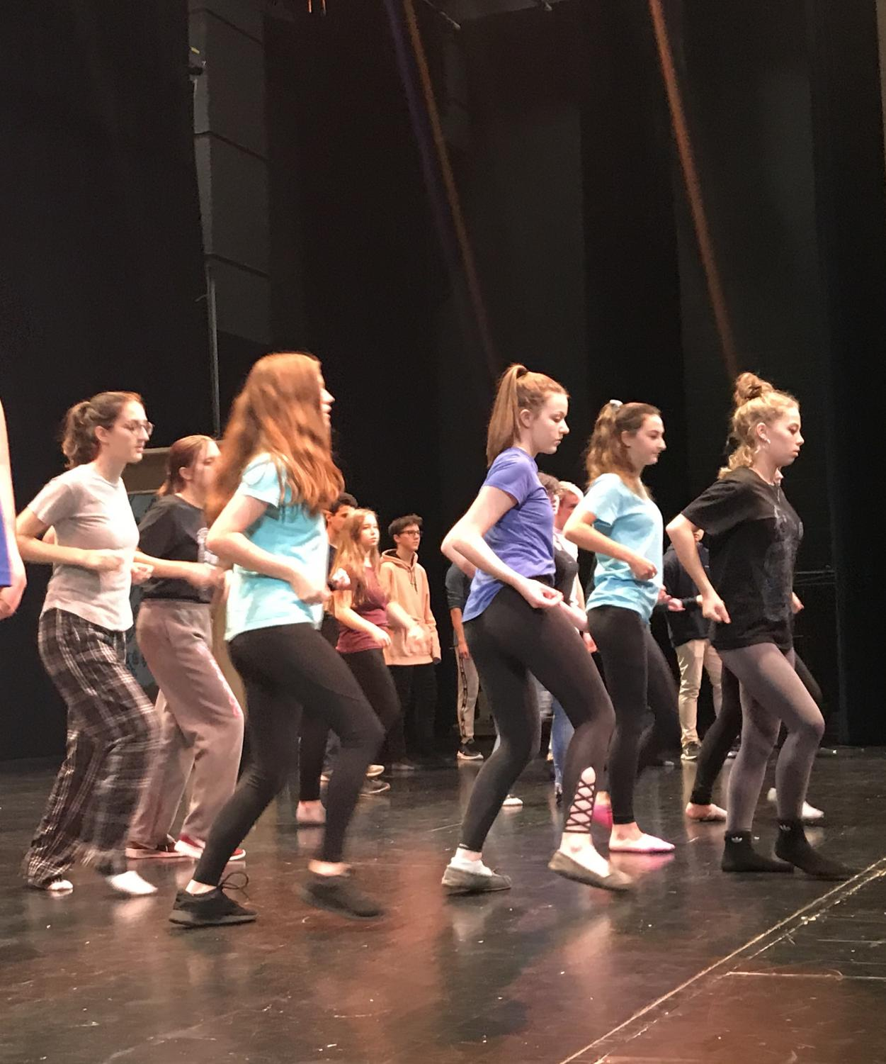 """As cast members rehearse their dance routines, they prepare for the """"West Side Story"""" performances. """"A major difference from 'High School Musical' is the dancing because it was modern day dances. 'West Side Story' is way more theatrical dancing, more founded in elements of ballet,"""" Wells said. They started performing in December after auditions."""