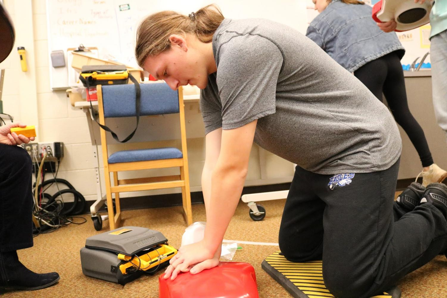 "Showcasing lifesaving CPR, junior Peter Snider gets tested for certification. ""If the situation were to arise, I can perform basic CPR on a person in need,"" he said. Every student physically able to get certified went through testing."