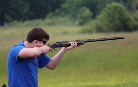 """As he focuses in, sophomore Charles Lucas pulls his BT-99. Charles Lucas Stoia received 94 out of a 100 points at States and the team ended in eighth place overall. """"I was proud of the whole team we worked really hard that year to make it to states,"""" Stoia said. """"I was very proud of myself, I practiced a lot to get good and all the hard work paid off."""""""