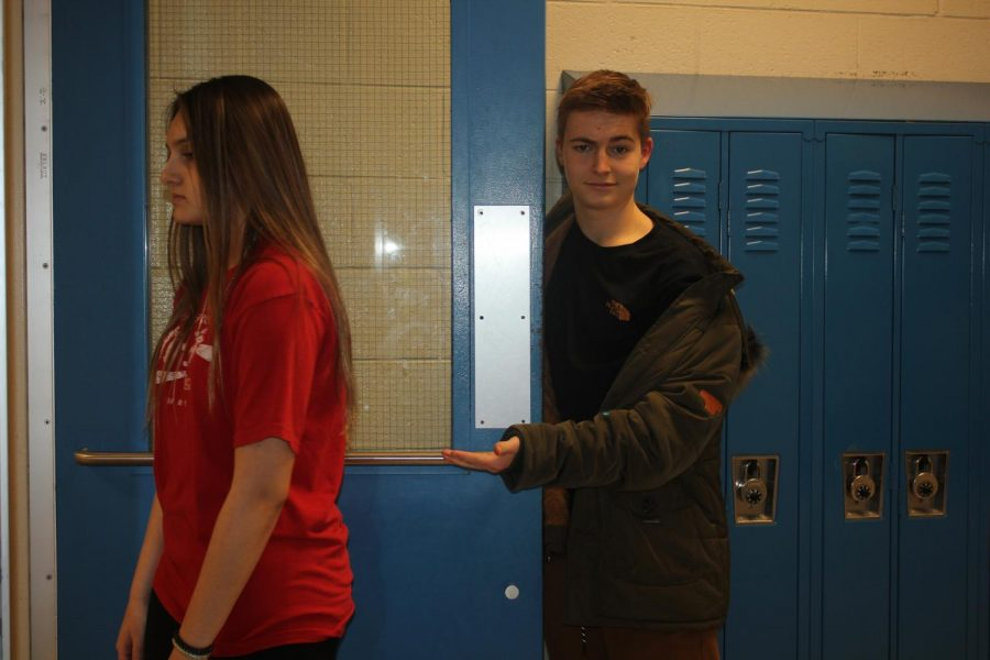 """Sophomore Brayden Schrieber holds a door open for Sophomore Piper Rodríguez. """"I would like [chivalry] to make a comeback."""" Rodríguez said. """"It's nice. It's pretty cute."""" Chivalry allowed people, especially men, to show kindness and love."""