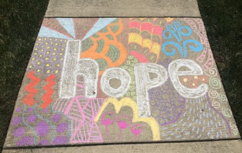 While enjoying the beautiful day on Saturday, I go outside with my sister. We had just gotten a big box of chalk, so we decided to make some cool designs; I did this and put it on the sidewalk, so when people come by they can see it. A day after this, it rained unfortunately so all of our drawings got washed away.