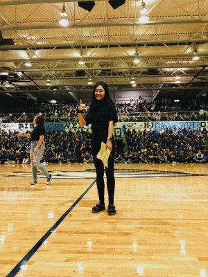 "Isabella Lee hosts the 2019 homecoming pep assembly. ""I was extremely anxious but was so excited to see everyone participating in the spirit day and being excited for the assembly,"" Lee said. After the homecoming pep assembly, Lee continued leading the student council events throughout the year and finding new leadership opportunities outside of school."