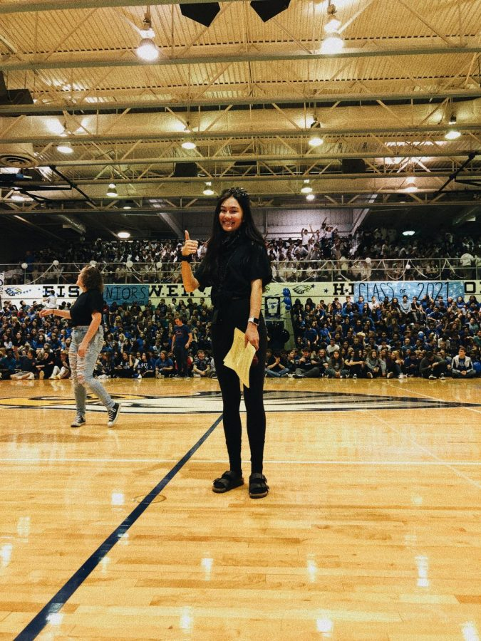 Isabella+Lee+hosts+the+2019+homecoming+pep+assembly.+%E2%80%9CI+was+extremely+anxious+but+was+so+excited+to+see+everyone+participating+in+the+spirit+day+and+being+excited+for+the+assembly%2C%E2%80%9D+Lee+said.+After+the+homecoming+pep+assembly%2C+Lee+continued+leading+the+student+council+events+throughout+the+year+and+finding+new+leadership+opportunities+outside+of+school.