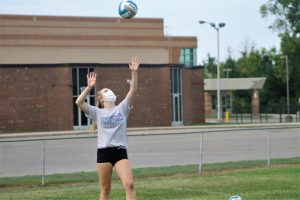 Reese Binando spikes the volleyball at tryouts in August. MHSAA decided that volleyball is one of the sports able to have a season this fall.