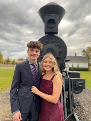 "Even though COVID cancelled school's homecoming plans, senior Kendall Westgate and junior Ryan Level make the best of the year. The couple went to Mae Stecker to take pictures and then went to eat at the Detroit Fish House Company. ""I definitely recommend having a fake homecoming,"" Westgate said. ""It"