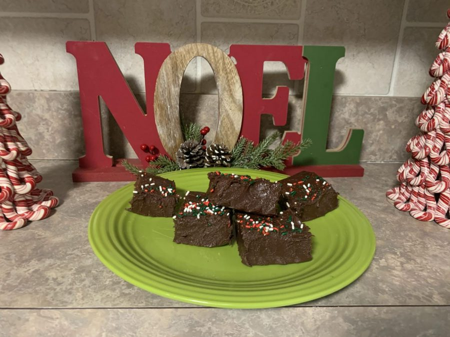 """After waiting two hours cool, junior Lauren Devereux cuts into the Christmas fudge. """"I really liked it and was surprised by how well it turned out, especially because she has never tried anything like that before,"""" Devereux's mother Jeanne Schleede said. The family enjoyed it and planned to make it again for the holidays."""