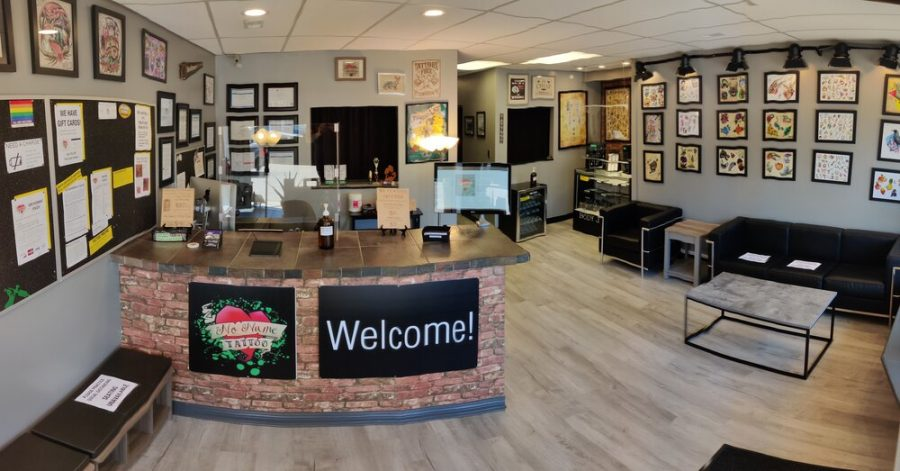 """In order to get her belly button piercing, junior Samantha Quartuccio when to No Name Tattoo. """"No Name tattoo shop was a very clean shop; I felt very comfortable there and Seth Dinardi was very good about answering all my questions,"""