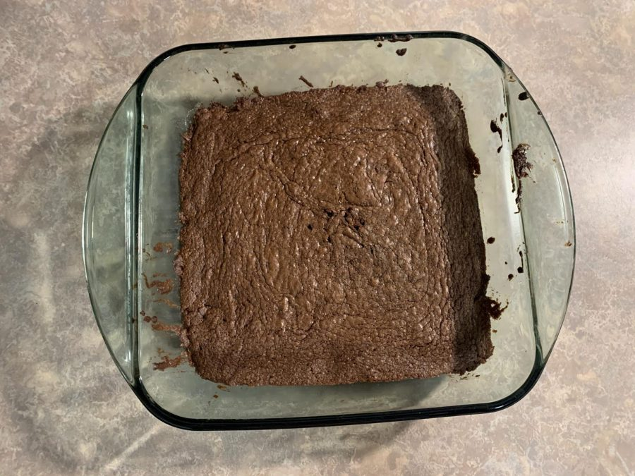 """After a few beginners mistakes, junior Lauren Devereux takes the freshly baked nutella brownies out of the oven. """"They were surprisingly good considering Lauren wasn't really prepared,"""" sister Olivia Schleede said. The family liked them and planned to make it again."""