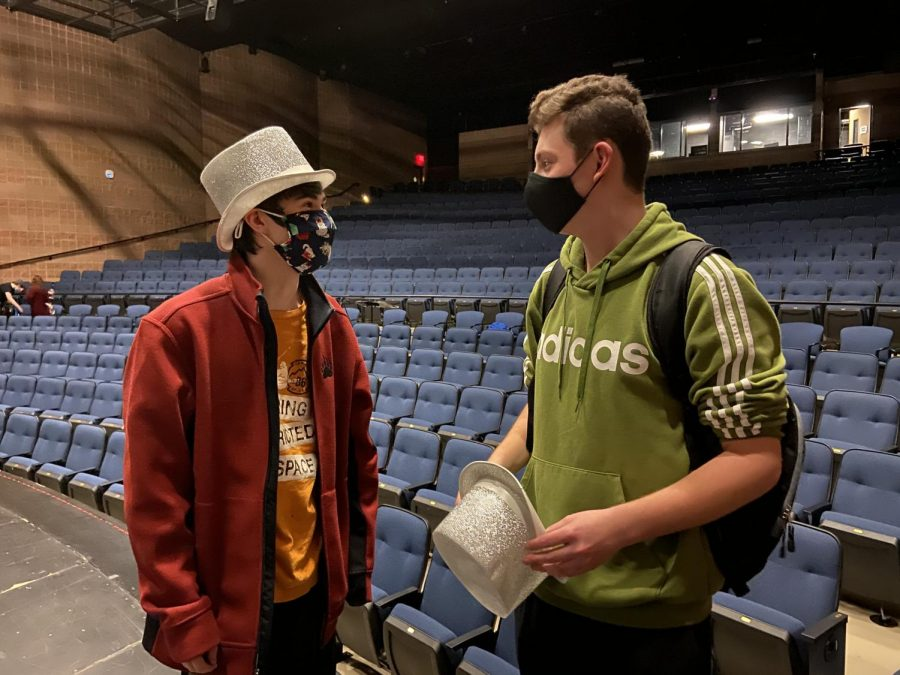 "After the first in-person rehearsal of the school year comes to a close, seniors Erik Smith and Joseph McGivern, who act as Al and Mike respectively, discuss the weather for the first time in months. ""It (the weather) decides it wants to be cold in all of the wrong areas and warm in all of the wrong areas, such as freezing over my windshield only,"" Smith said. They left rehearsal ready to come back the next day."