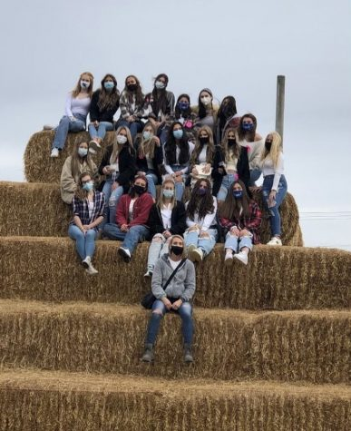 "Cheerleaders take a trip to the cider mill. ""We got to eat donuts, pick apples, go on the hayride and much more,"" senior varsity cheerleader Mia Doncic said. ""It was really fun bonding with the team outside of cheer."" The trip was a team bonding activity."