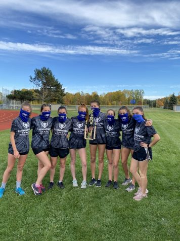 "While working hard, the girls cross country team takes a photo during practice. ""Being a senior, all we want as a team is to have one last normal season together,"" senior Lauren Lutz said. The athletes continue to look forward to participating in spring sports."