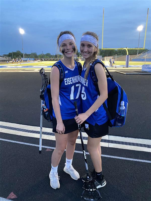 """After working hard, juniors Gretchen Kulin and Nicole Panczyk go home after a game. """"I chose to switch to online so I could prevent getting quarantined so I would not miss out on the playoffs,"""" junior Gretchen Kulin said. They look forward to playing more games together in the future and making more memories."""