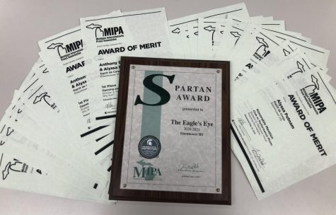 The Michigan Interscholastic Press Association winning staff earns a Spartan plaque and certificates for individuals.