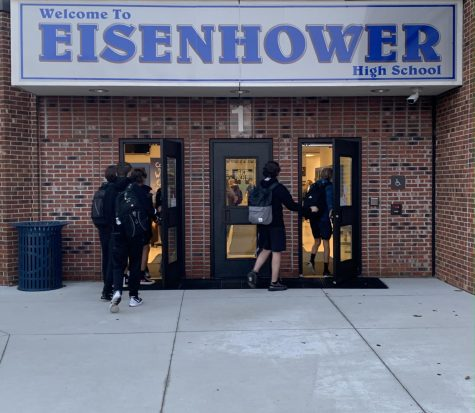 """Walking into school, students arrive early to be in class on time. """"I hate the [updated] attendance policy; its unfair. Say you are on vacation and its a five day vacation, it affects you,"""" junior Selena Dooda said. The updated rules and regulations promote timeliness and clarifies excused and unexcused absences."""